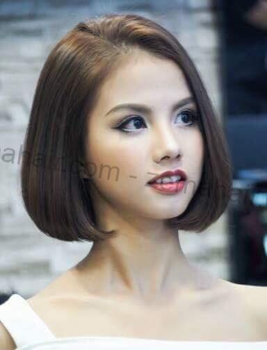 Kiểu tóc uốn phồng với phần mái lệch sang một bên trông thật quý phái cho cô nàng