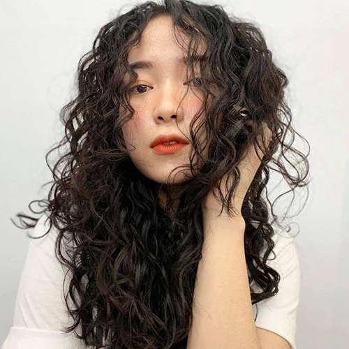 Tóc bính xù kết hợp mái xoăn dài