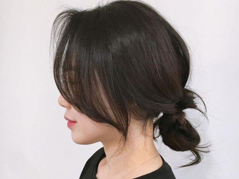 Tóc búi thấp kết hợp mái dài đầy nữ tính
